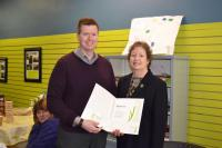 Jeff accepts a certificate from Mayor Sue Paterson